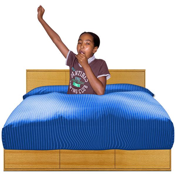 teenage girl yawning in bed
