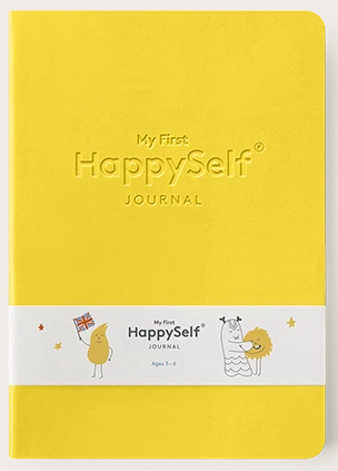 yellow front cover of a happy self journal book